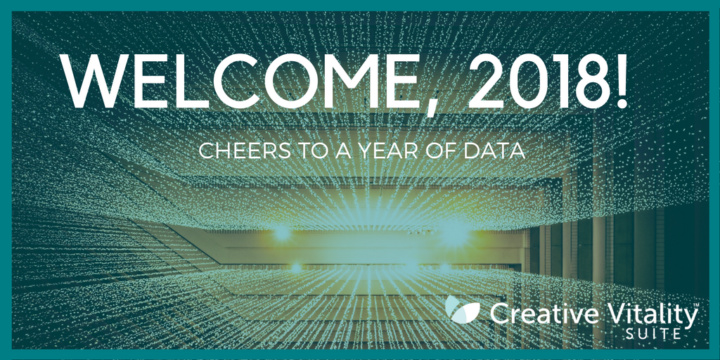 An abstract image with smaller lights moving toward the larger light. Text reads: Welcome, 2018! Cheers to a year of data