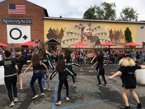 A bunch of people outside dancing in Kingston, New York