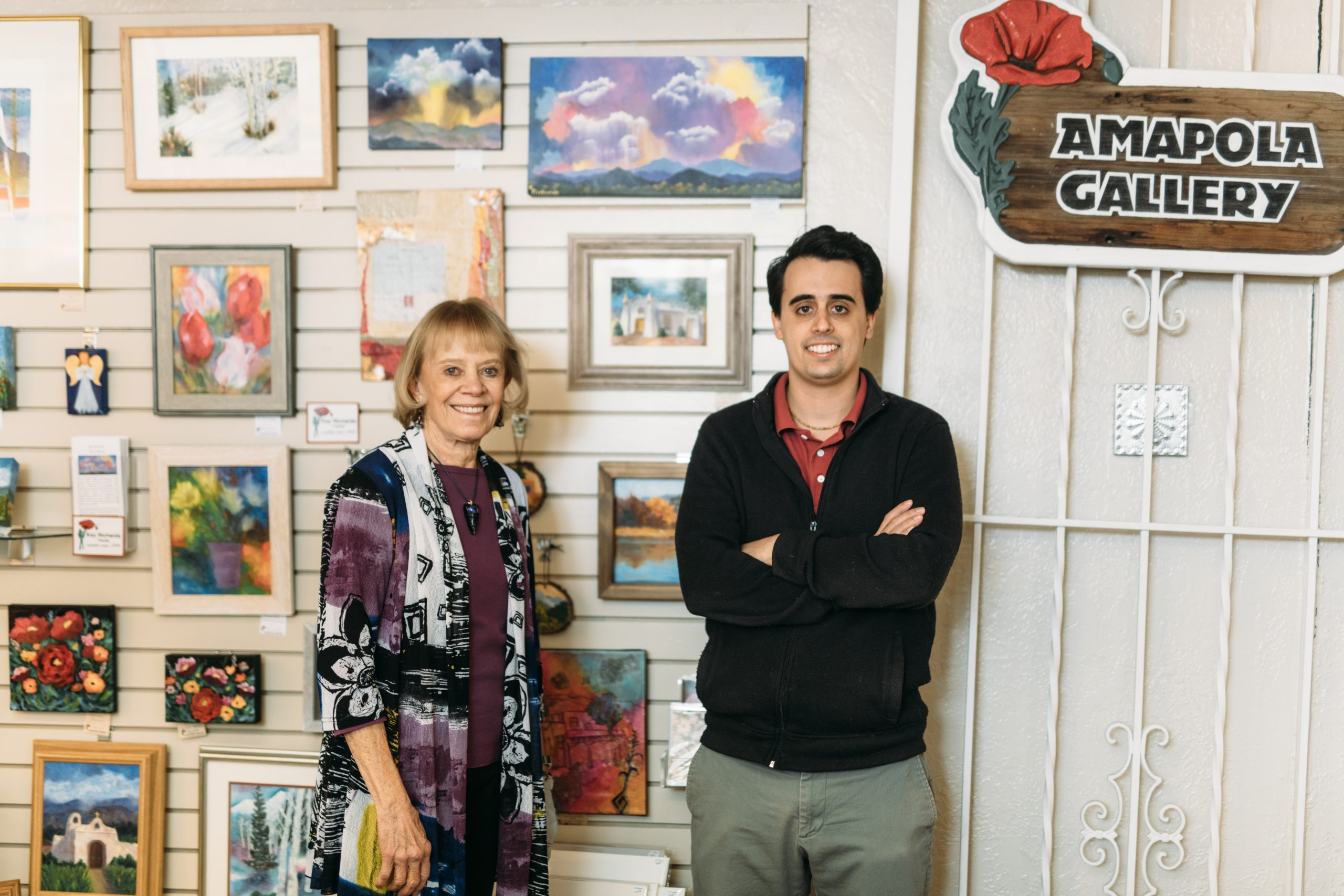 An image of two people who are gallery owners of Ampola Gallery in Albuquerque