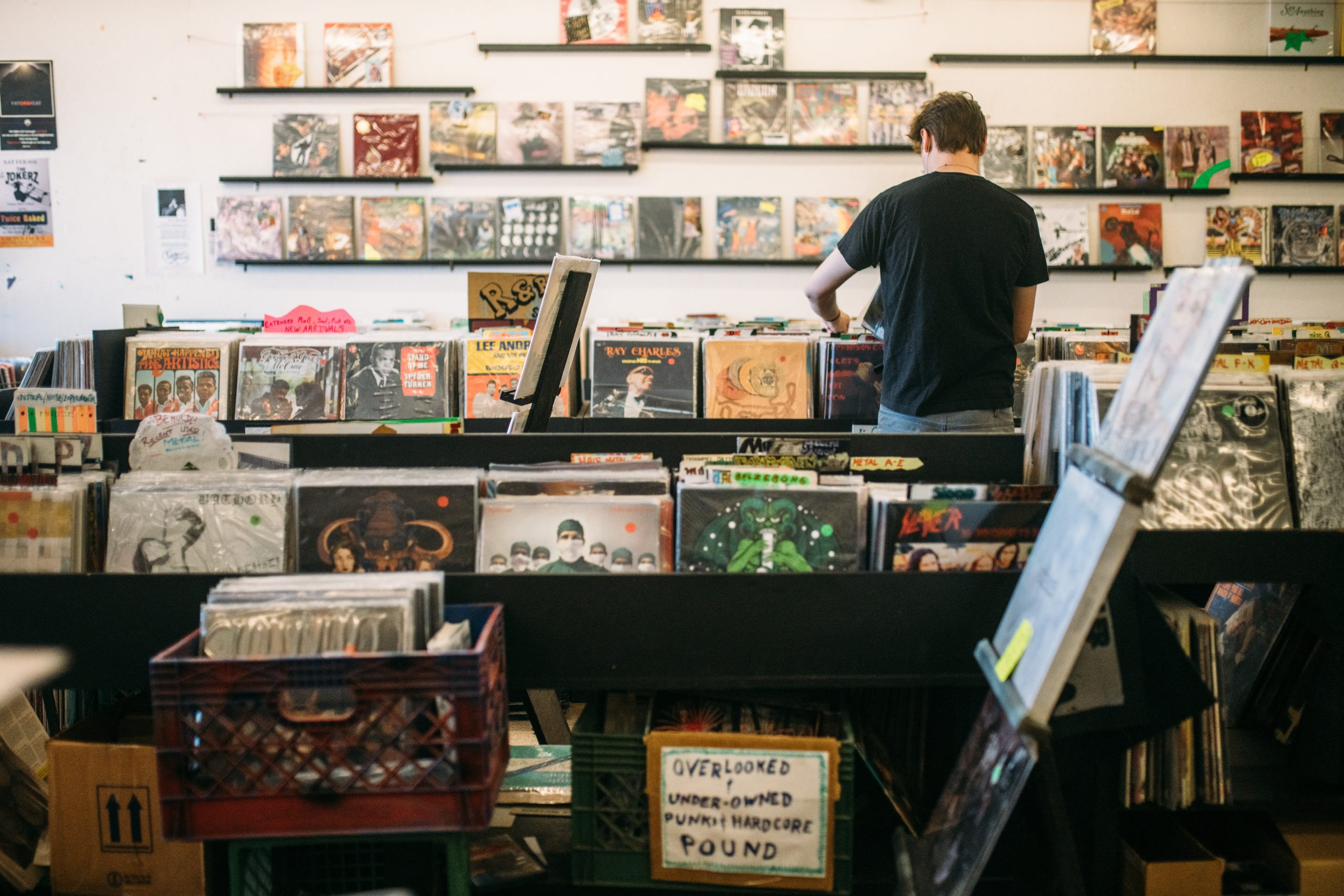Guy shopping at a record store